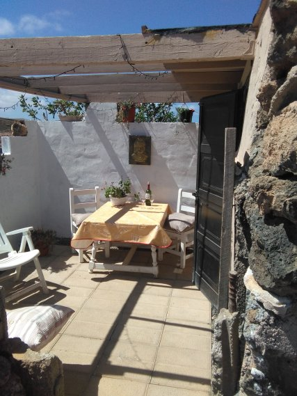 Ocean Glory Eco casita or Le van static campervan sunny outdoor seating for eating and sunbathing