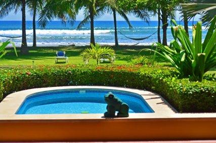 Private plunge pool in Deluxe Beachfront Villa room.