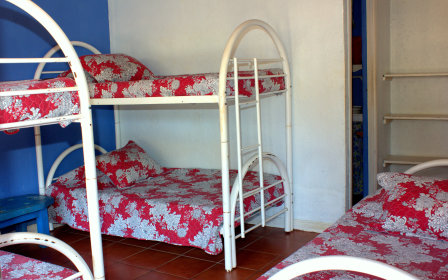 2 bunk beds and one single bed