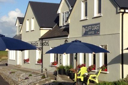 Doolin Hostel  Over looking the village and out to sea, enjoy an Irish Craft beer on a sunny afternoon on our garden terrace