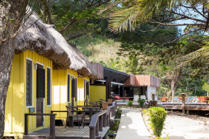 Thatched Beachfront Bures with own bathroom and open air shower. Ceiling Fan cooled, private decks on the beach, bar fridge, tea, coffee making facilities'.