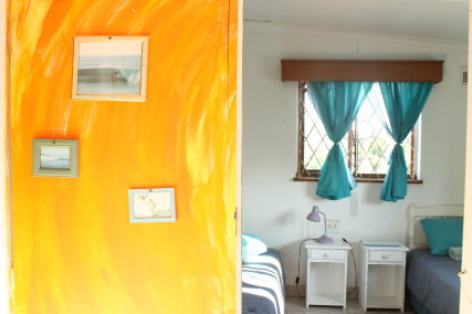 Our twin room is light, airy and has garden views